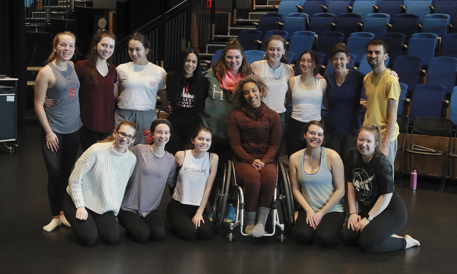 "Students in ""Intermediate Modern Dance Technique"" gather for a group photo with Assistant Professor of Dance Caitlin Mahon, Professor of Dance Cadence Whittier and Guest Artist Alice Sheppard in Deming Theatre."