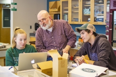 Professor of Biology Mark Deutschlander helps Eleanor Burns âX and Colton Corriveau '21 with an assignment during a biology lab in Napier Hall.
