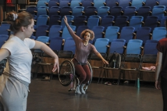 """Guest Artist Alice Sheppard demonstrates a movement during """"Intermediate Modern Dance Technique"""" with Assistant Professor of Dance Caitlin Mahon . An award-winning choreographer, Sheppard focuses on creating movement that challenges conventional understandings of disabled and dancing bodies."""