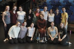 """Students in """"Intermediate Modern Dance Technique"""" gather for a group photo with Assistant Professor of Dance Caitlin Mahon, Professor of Dance Cadence Whittier and Guest Artist Alice Sheppard in Deming Theatre."""