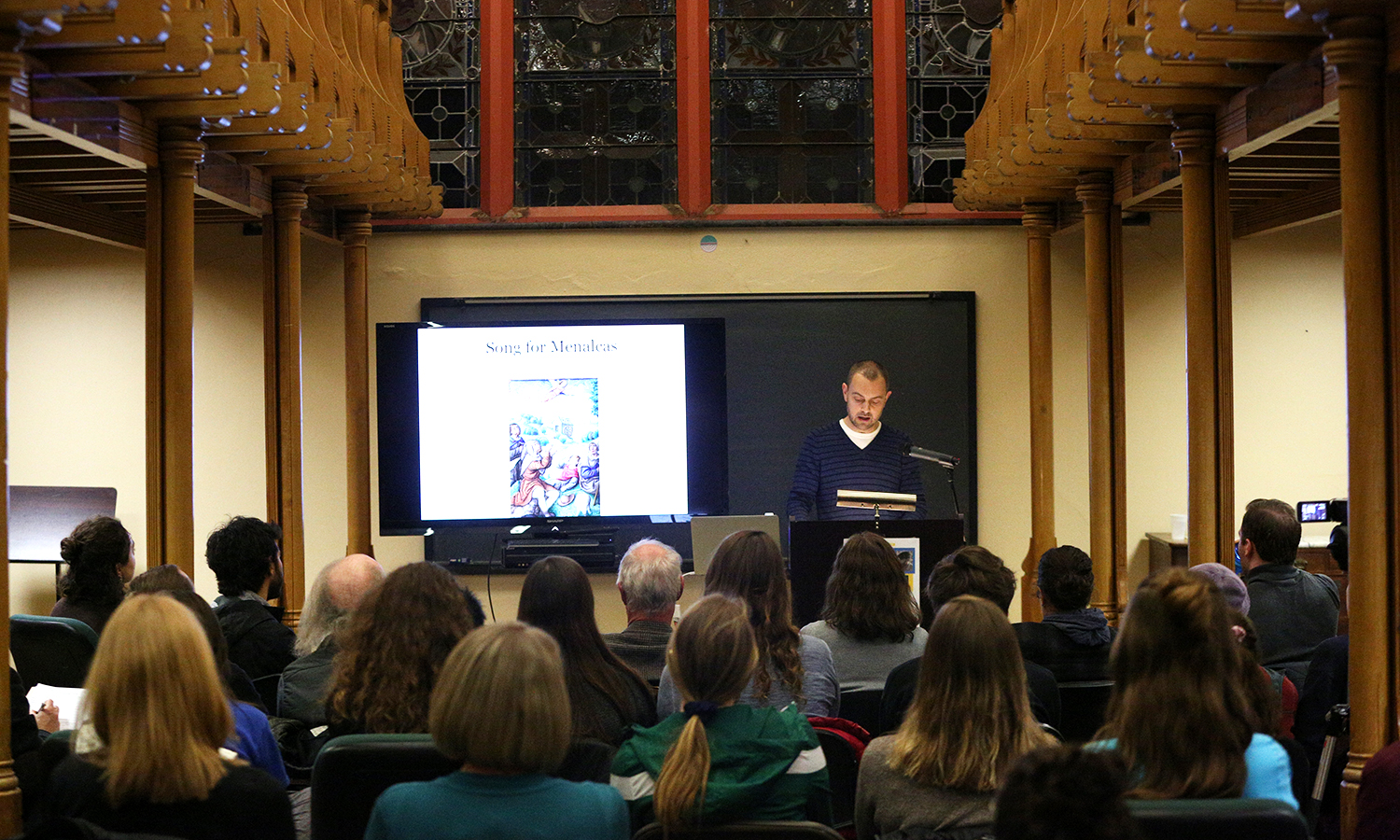"""Assistant Professor of English and Comparative Literature Geoffrey Babbitt delivers a reading from his new book, """"appendices pulled from a study on light,"""" in the Blackwell Room on Wednesday."""