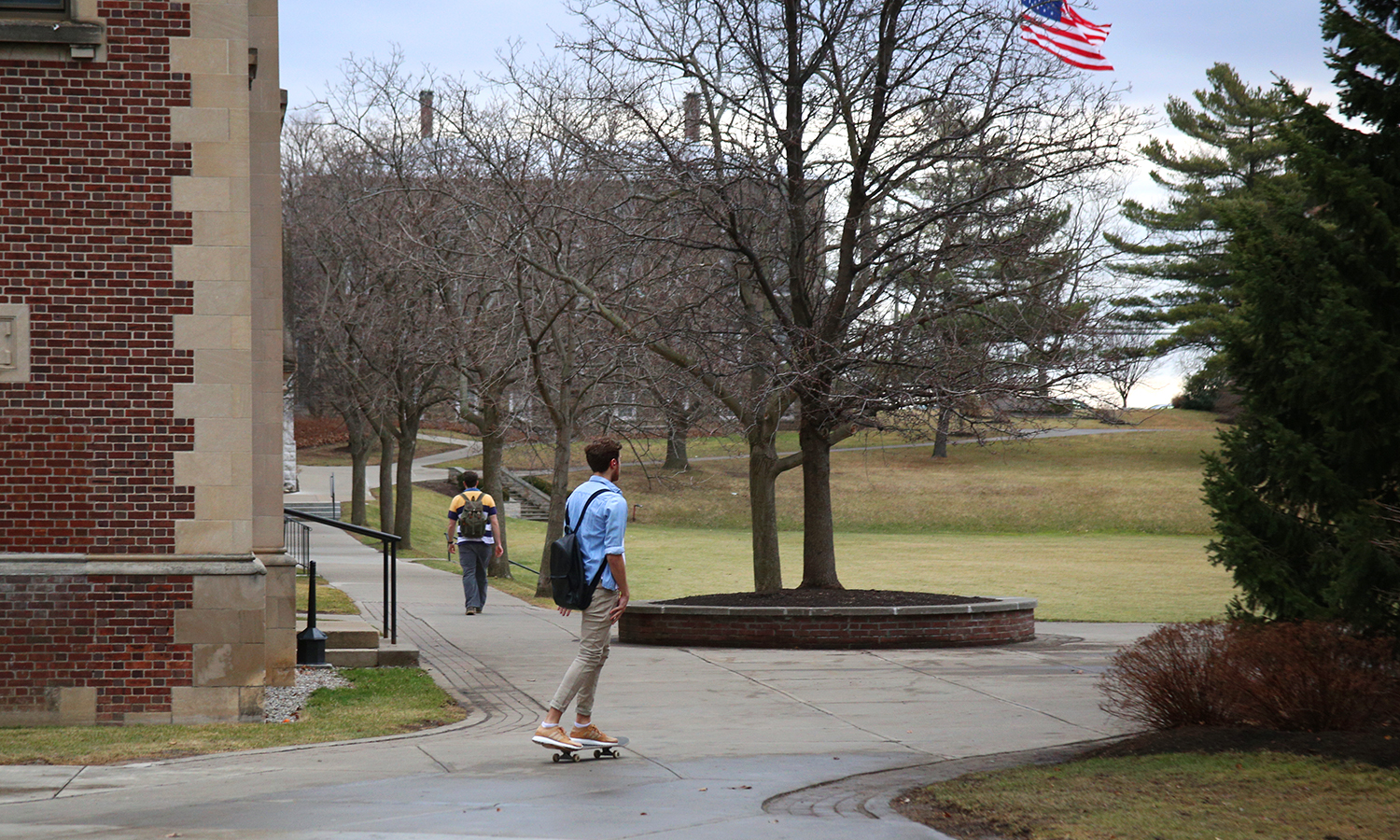 Harrison DeMaria skateboards through campus on Tuesday.