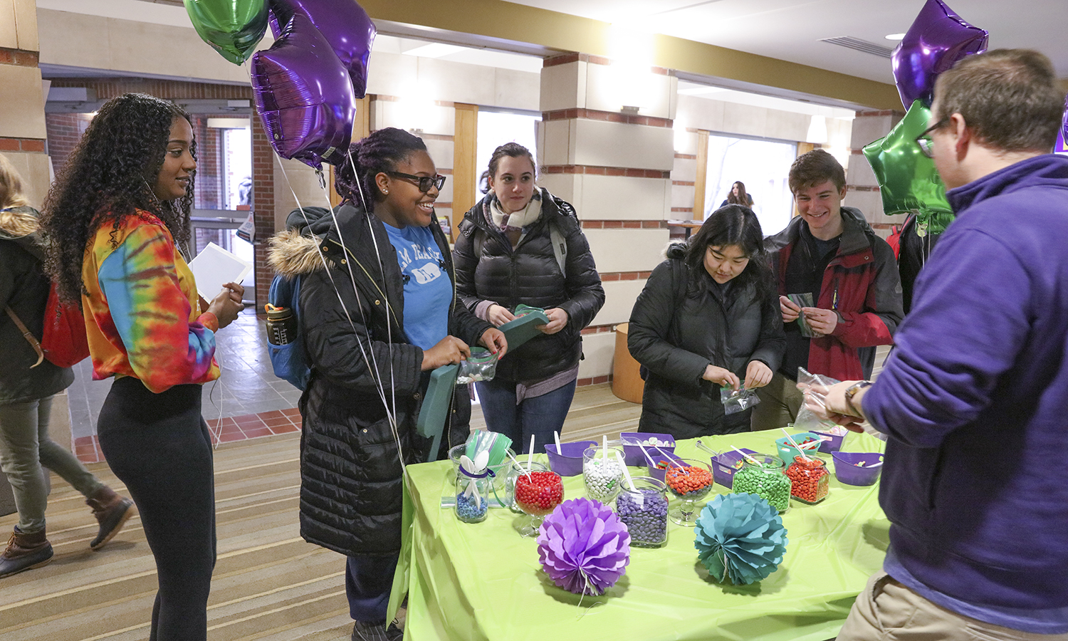 """Students create customizes bags of M&Ms as part of """"Fun Friday"""" in the Scandling Campus Center."""
