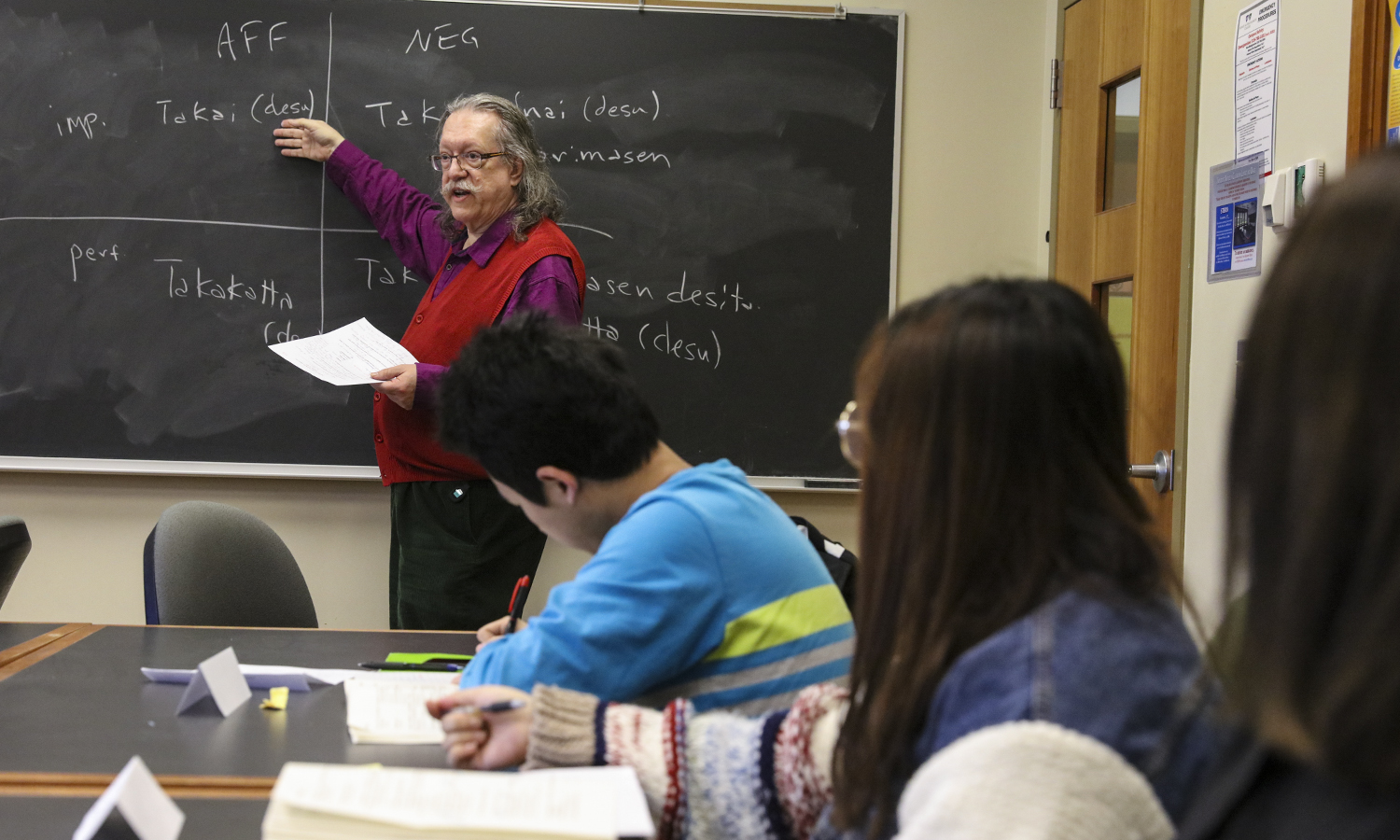 """In Stern Hall, Associate Professor of Asian Studies James-Henry Holland describes the grammatical structures of adjectival sentences to students in """"Beginning Japonese."""""""