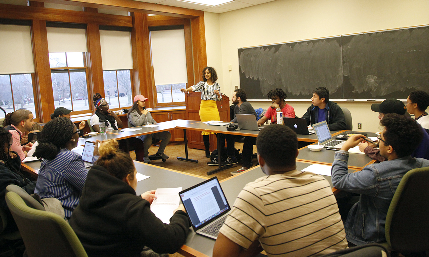 In Stern Hall, Interim Chief Diversity Officer Solomé Rose (center) leads discussion during a roundtable meeting with the Office of Diversity and Inclusion.