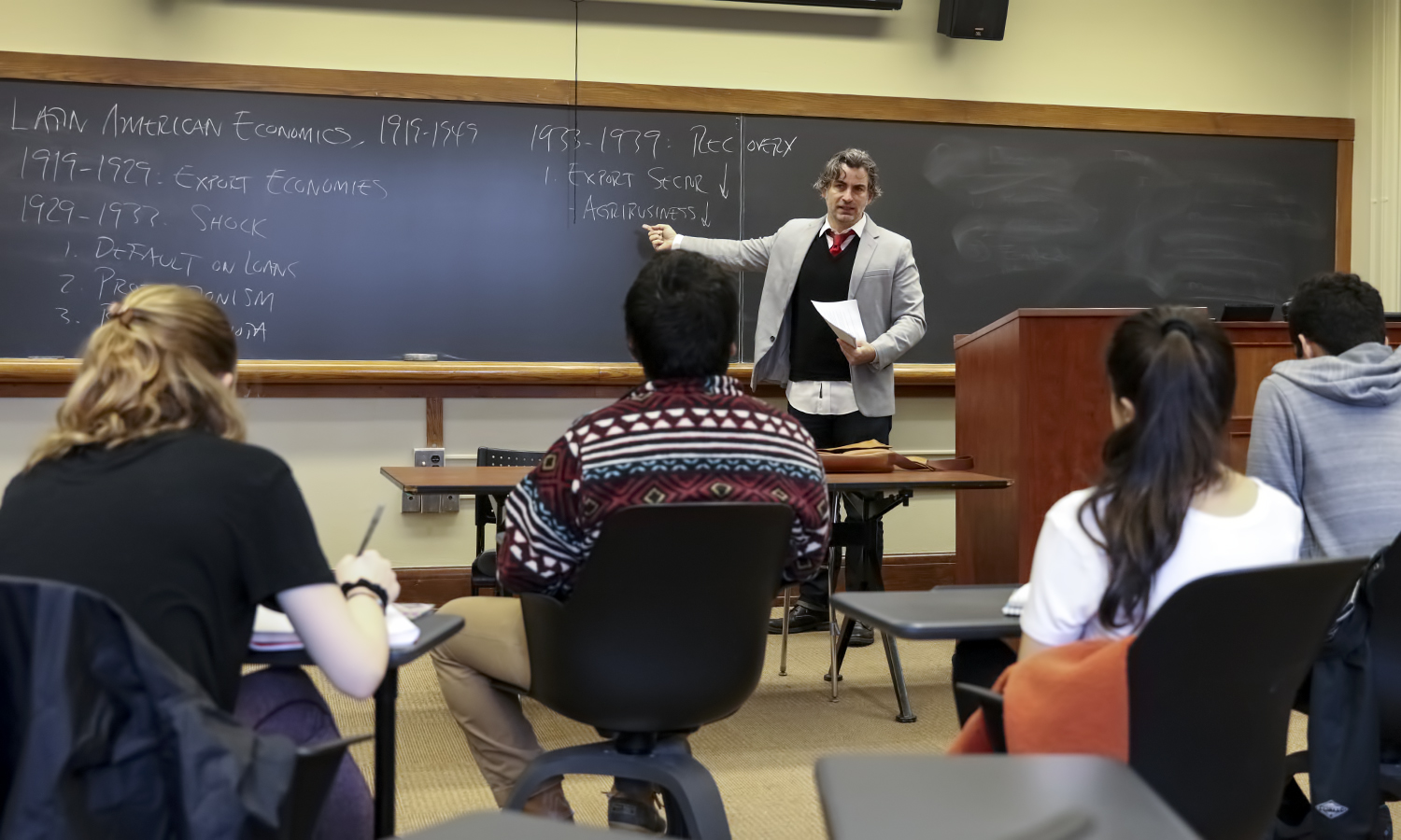 """Associate Professor of History Colby Ristow discusses the history of economics in Latin America as part of """"X"""" in Stern Hall."""