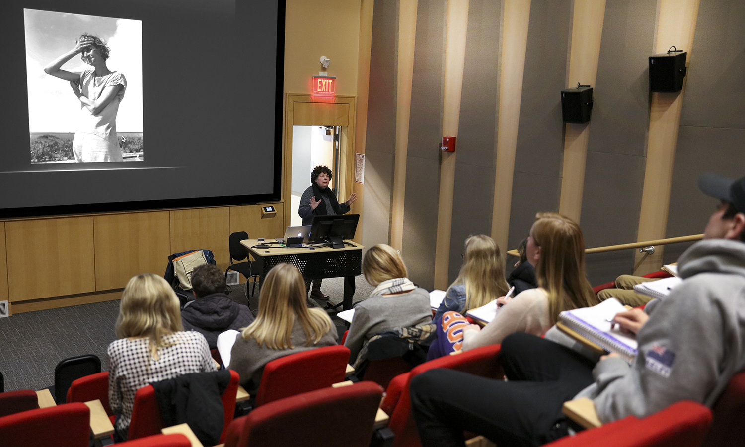 Professor of Media and Society Linda Robertson talks about X with students as part of X in the Fish Screening Room of the Gearan Center for the Performing Arts.