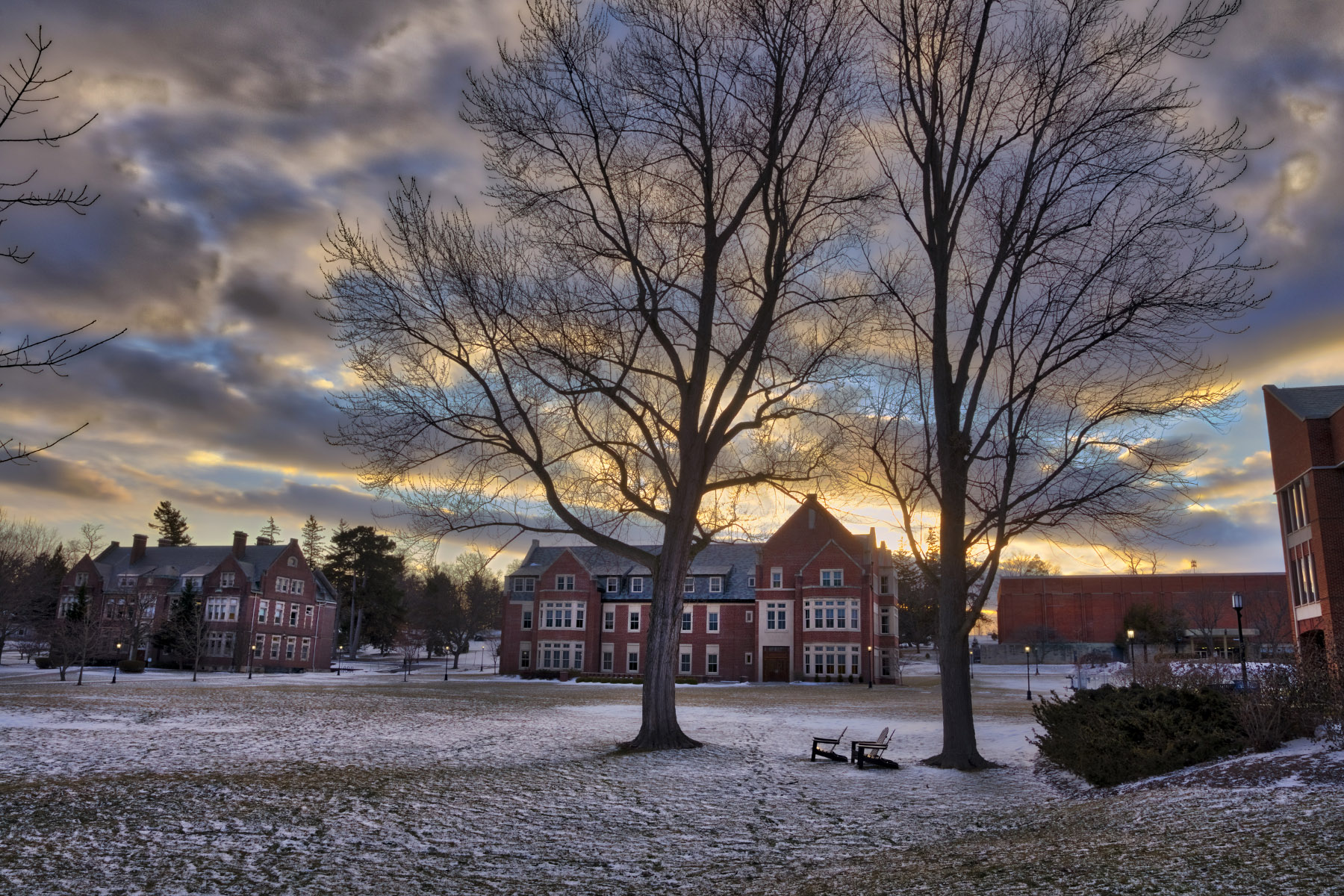 The sun sets behind Stern Hall on Monday.
