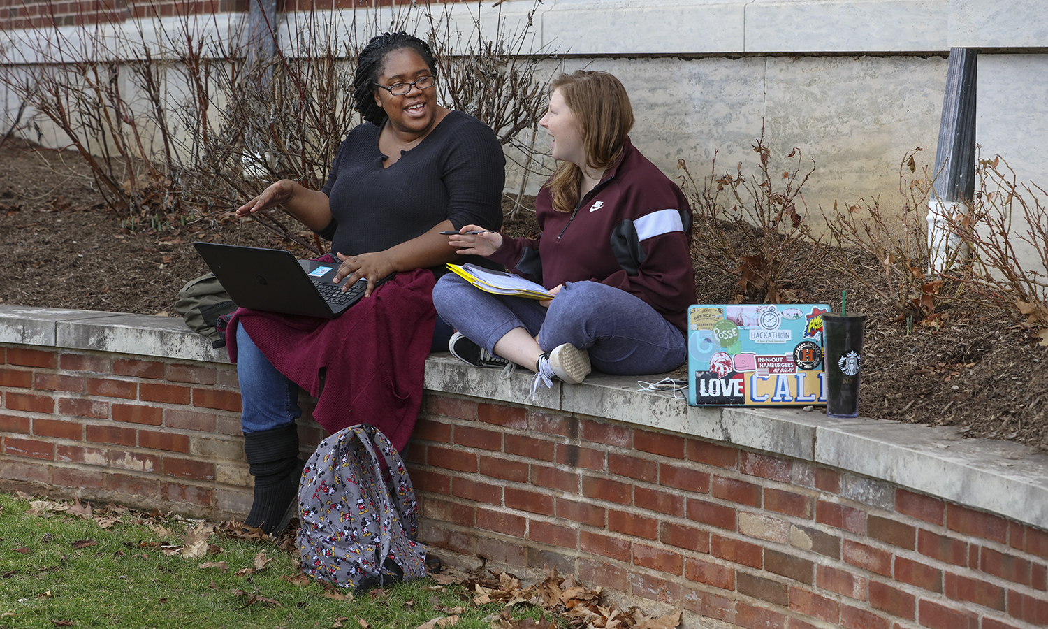 Whitney Campbell '18 and Saoirse Scott '19 talk while working outside of Gulick Hall on Thursday afternoon.