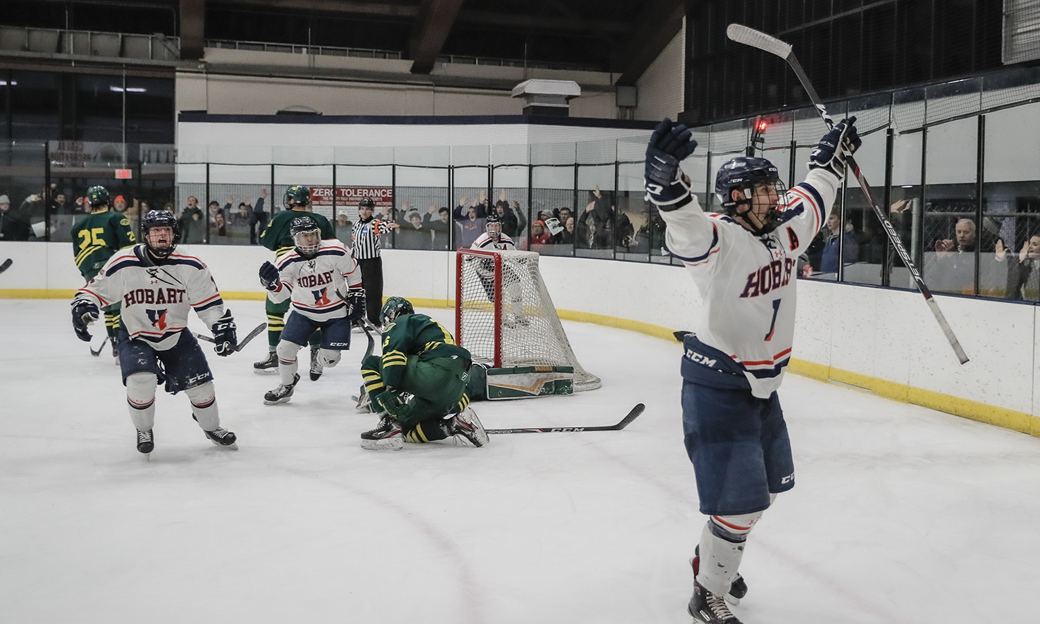Travis Schneider '21 celebrates Hobart Hockey's third goal to lift the Statesmen over Skidmore College in the semifinal round of the New England Hockey Conference tournament.