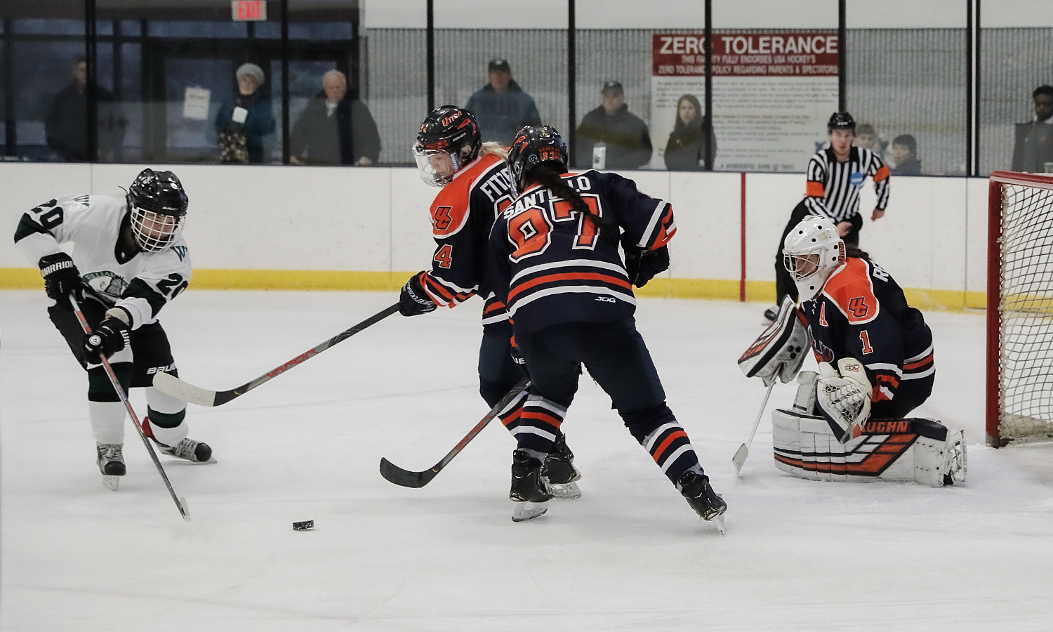 Julianna Gong '23 challenges the Utica defense. William Smith Hockey won 2-1.