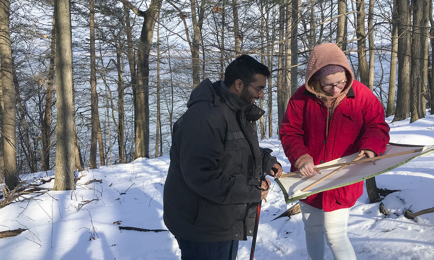 Under the direction of Associate Professor of Biology Meghan Brown, Alvin Randall â19 and Mikayla Meyer â20 look for biocontrol beetles in Hemlock trees at the VanRiper Preserve of the Finger Lakes Land Trust.