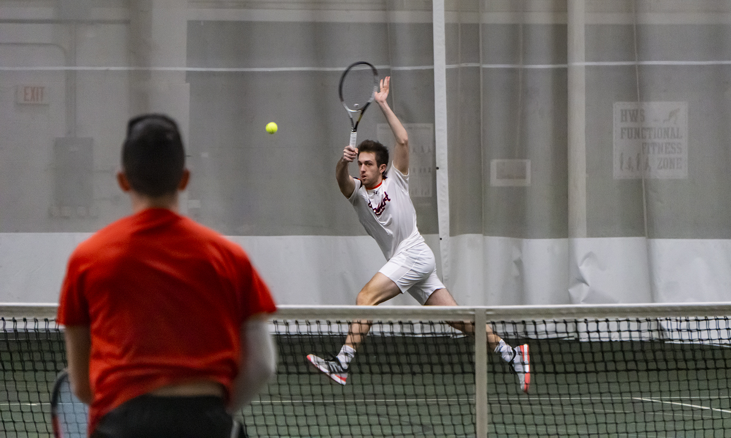 Alan Dubrovksy '20 reaches for a forehand return during Hobart's victory over Oneonta State.