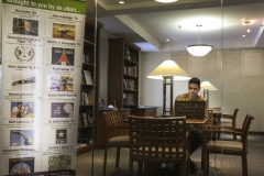 Hamdan Ahmed 2020 Career Assistant works in the career center library.