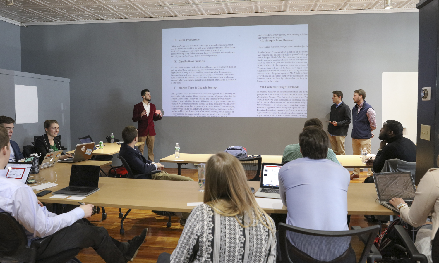 Nimer Farhood '18, Jonah Gould '19 and Adam Enxing '19 present their marketing strategy for a new sausage at Madia's Italian Market as part of their senior capstone course in the Bozzuto Center for Entrepreneurship located in downtown Geneva at 22 Castle Street.