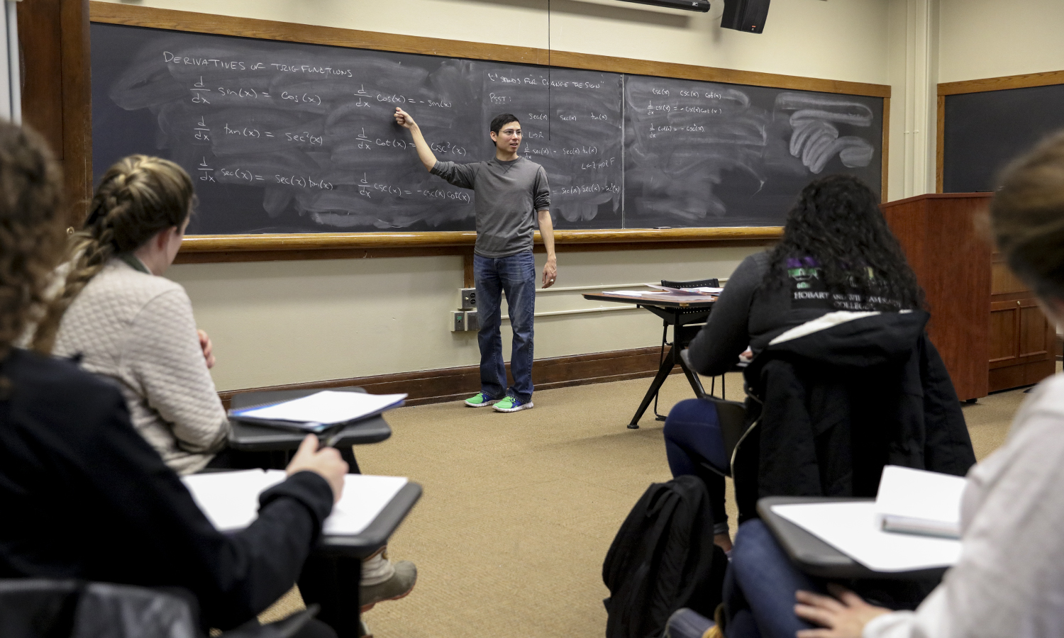 "Visiting Assistant Professor of Mathematics & Computer Science T. Alden Gassert reviews derivatives of trigonometric functions during ""Calculus I"" in Stern Hall."