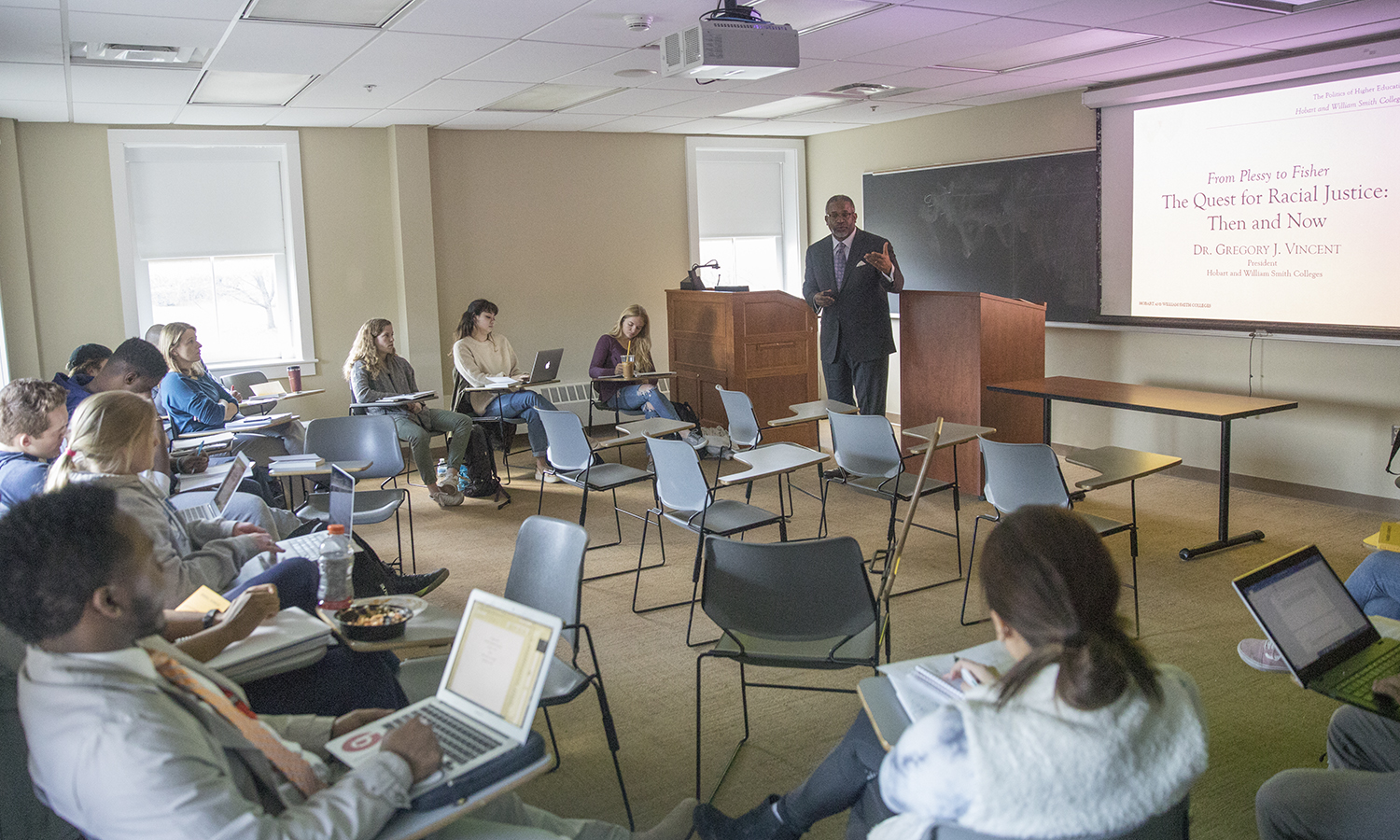 """President Gregory J. Vincent '83 delivers his talk, """"From Plessy to Fisher. The Quest for Social Justice: Then and Now"""" to students in """"Politics in Higher Education"""" with Assistant Professor of Political Science Justin Rose in Stern Hall."""
