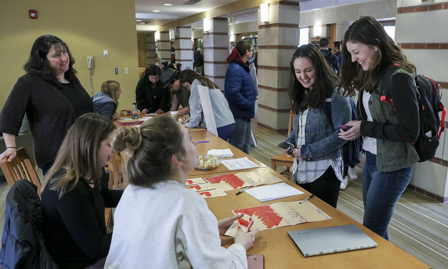 Director of the Abbe Center for Jewish Life and Hillel adviser Julianne Miller (left), Jordannah Schreiber '18 and Grace Martel '18 talk with Jacque Kane '18 and Katy Bjornson '18 while tabling on behalf of HWS Shabbat in Scandling Campus Center.