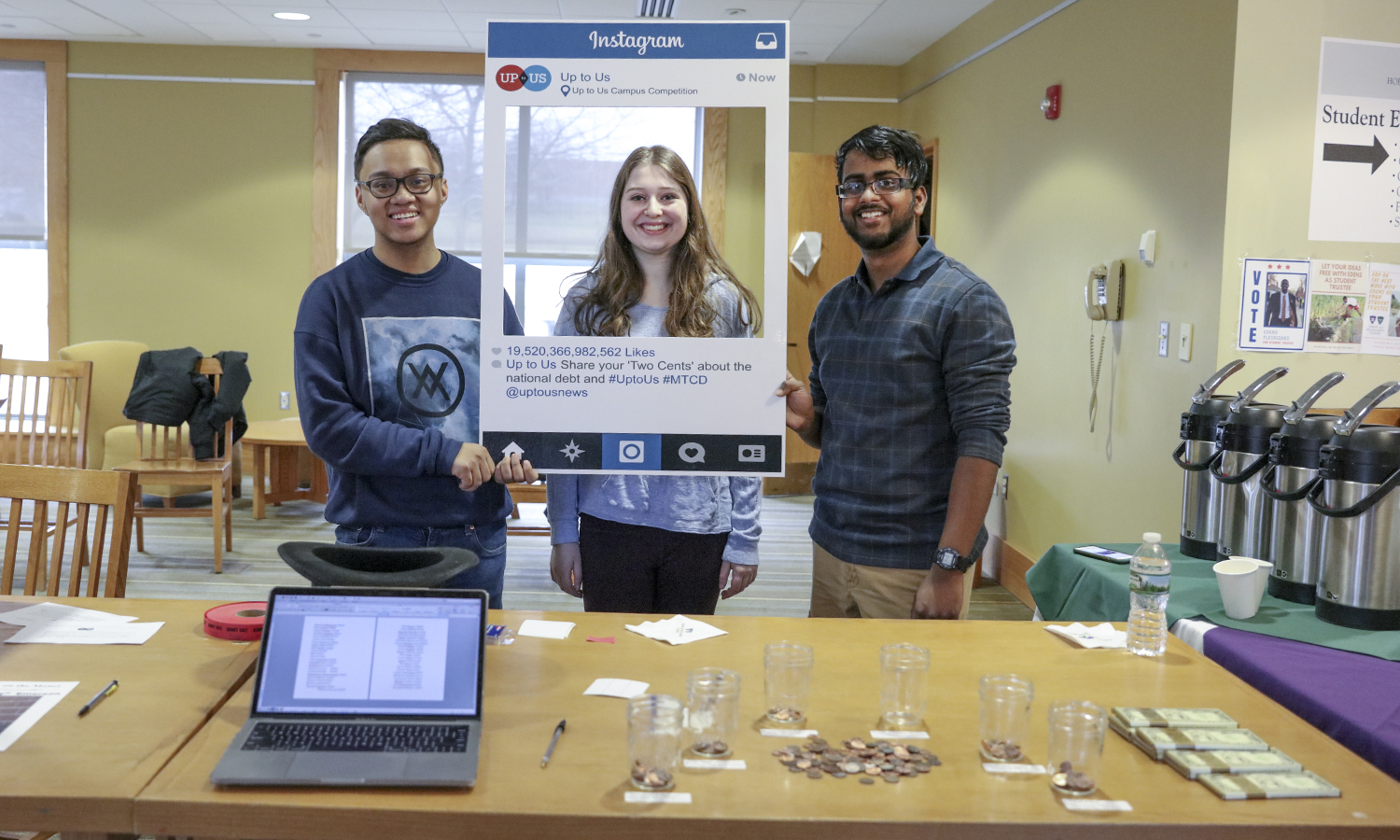 "John Camara '19, Mikaela Zallen '20 and Albright Dwarka '21 pose for a photo during the ""My Two Cents"" event, which gave students the opportunity to win $100 by placing their ""two cents"" in one of seven coin-banks that symbolize different solutions to the debt."