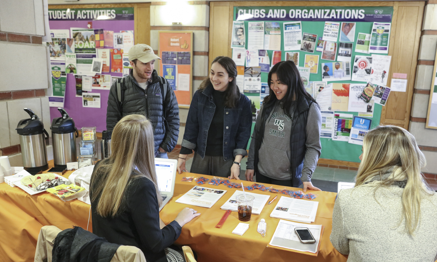 """Dan Magin 'X, Elise Wyatt '18 and Lily Kane """"X speak with recruiters from Success Academy Charter Schools in Scandling Campus Center."""