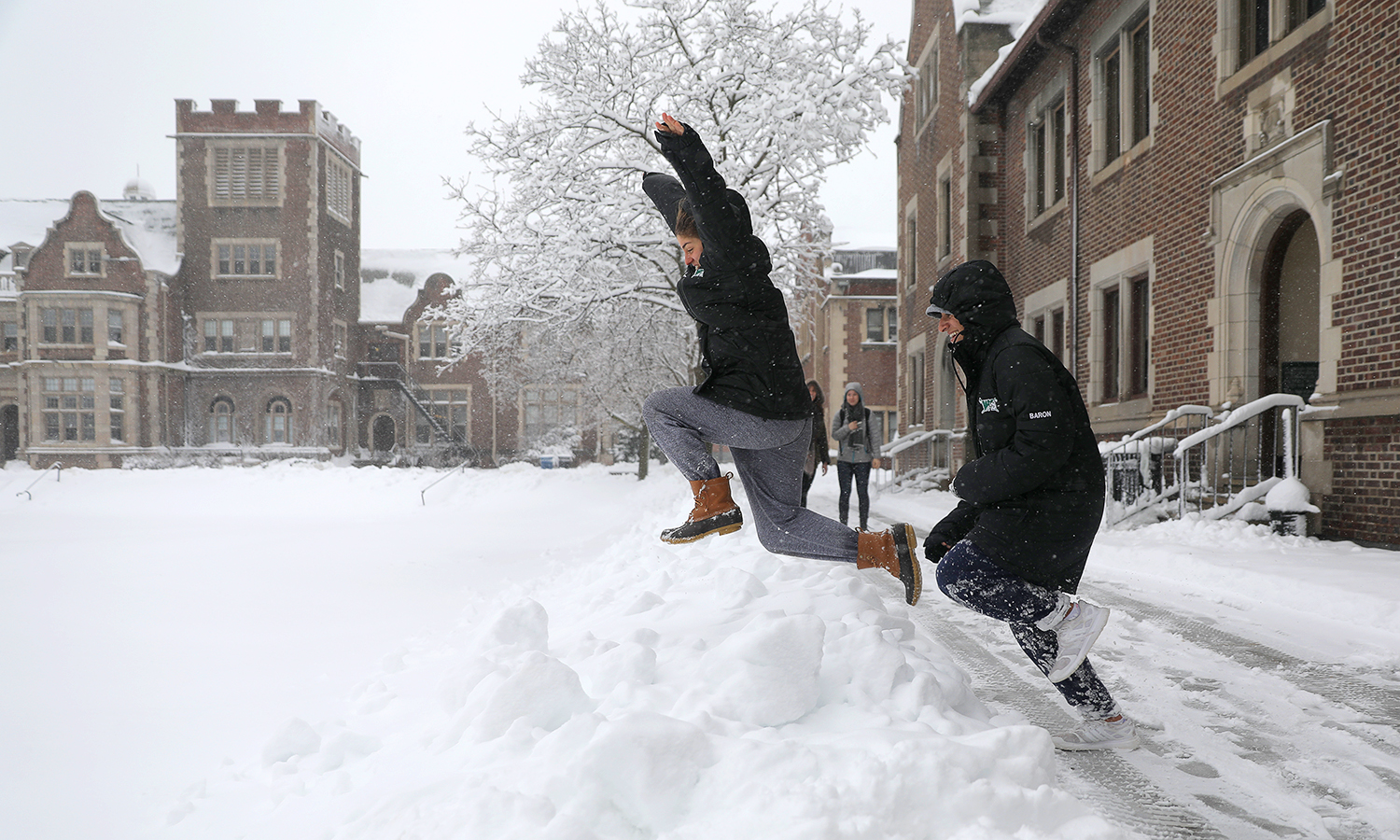 Emma Lubrano 'X and Hannah Baron 'X take advatage of a fresh snowfall on the Quad on Friday morning.