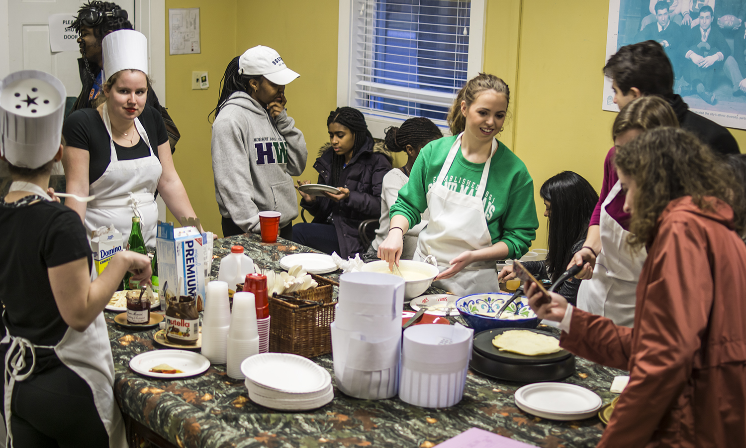 Members of the HWS French Club make crepes during a club meeting in the Office of Intercultural Affairs.
