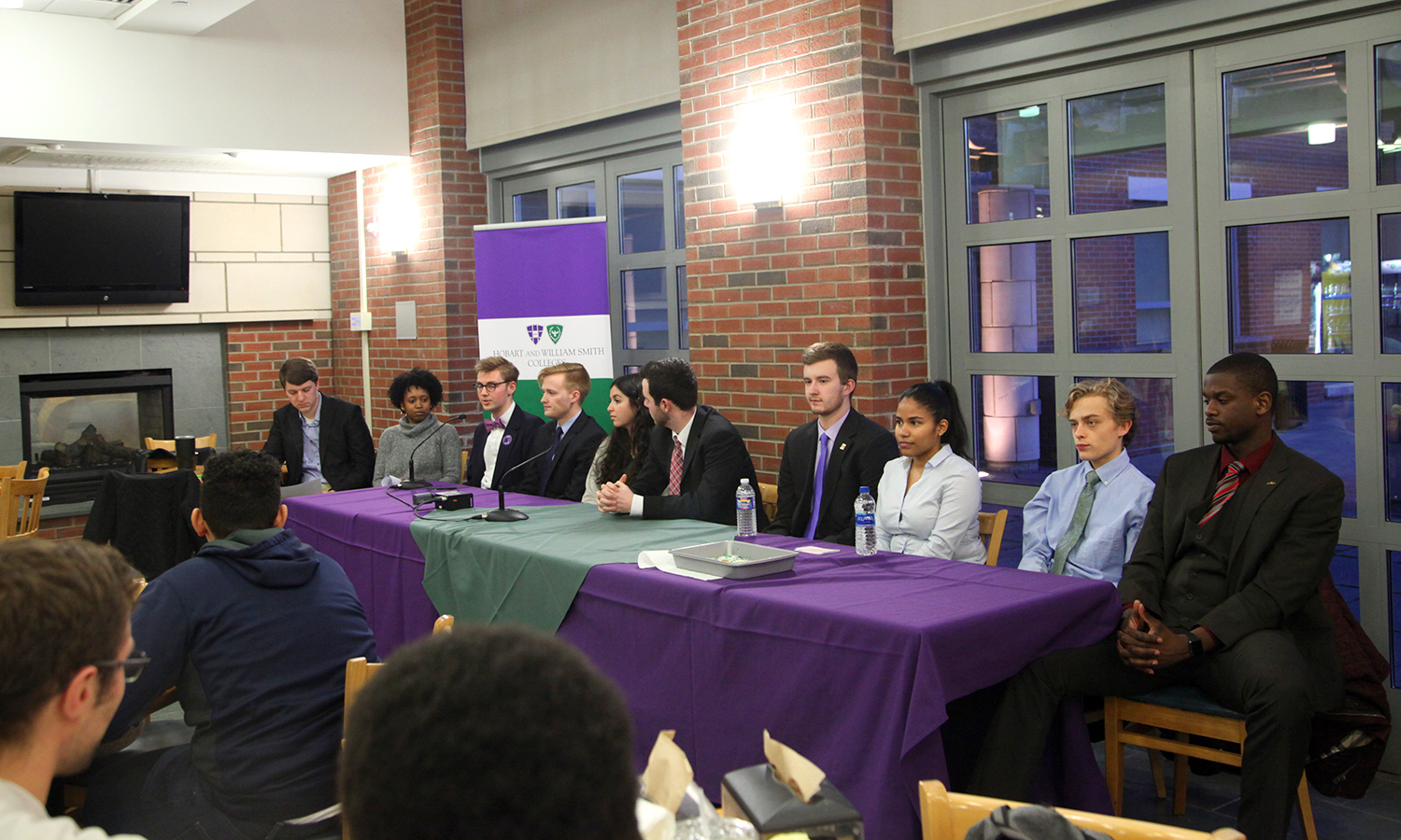 This year's candidates for Student Trustee gather in the Scandling Campus Center café to answer questions. Elections will take place online on Friday, March 2.