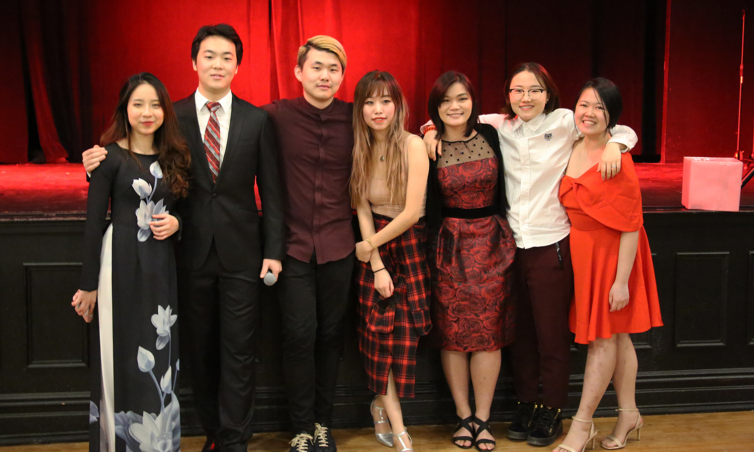 Asian Student Union board members pose for a photo following the Lunar New Year dinner celebrating the end of the Year of the Rooster and welcoming the Year of the Dog.