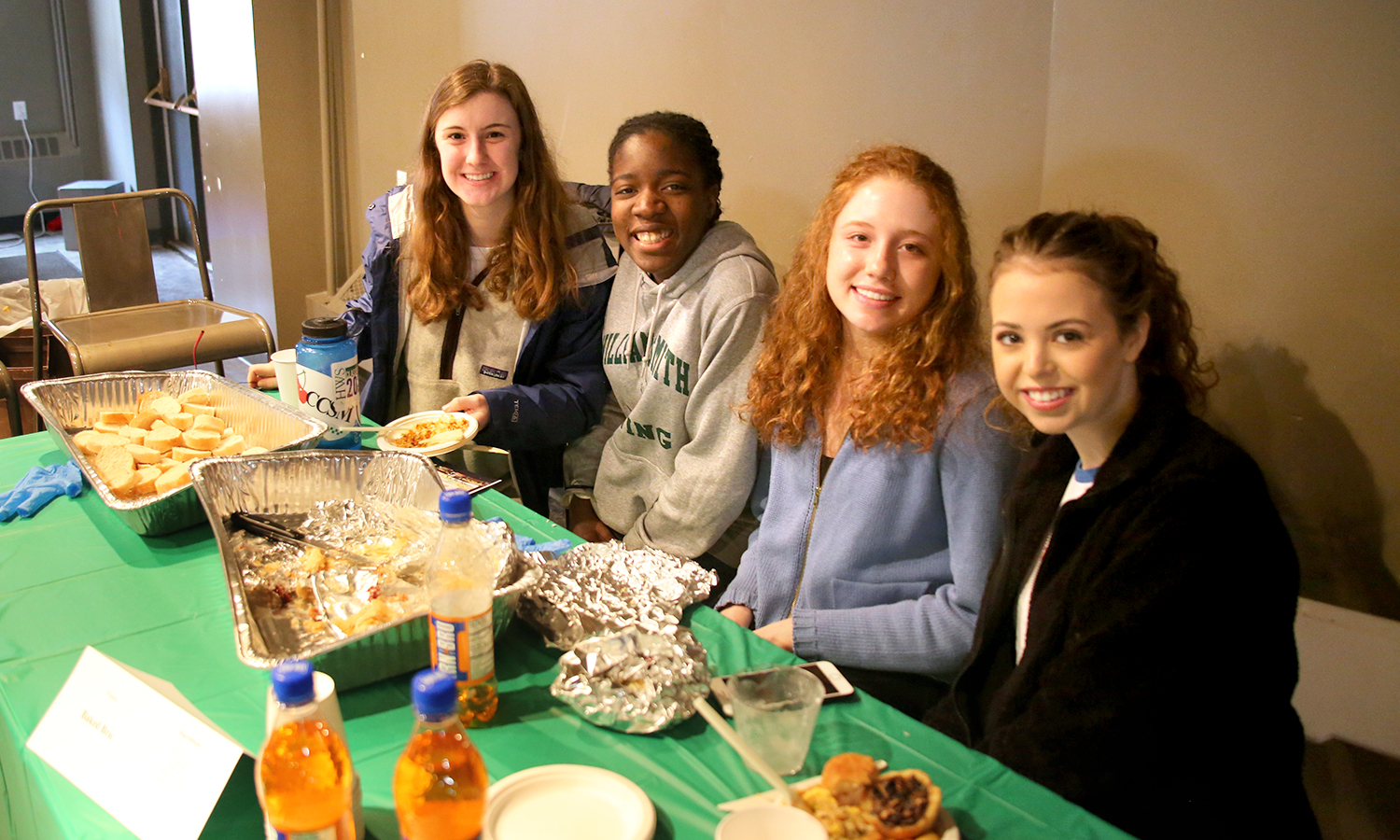"""Students experience a sampling of food and drinks during the """"Taste of the World"""" event in the Barn on Sunday afternoon. The event was organized by the Latin American Organization."""