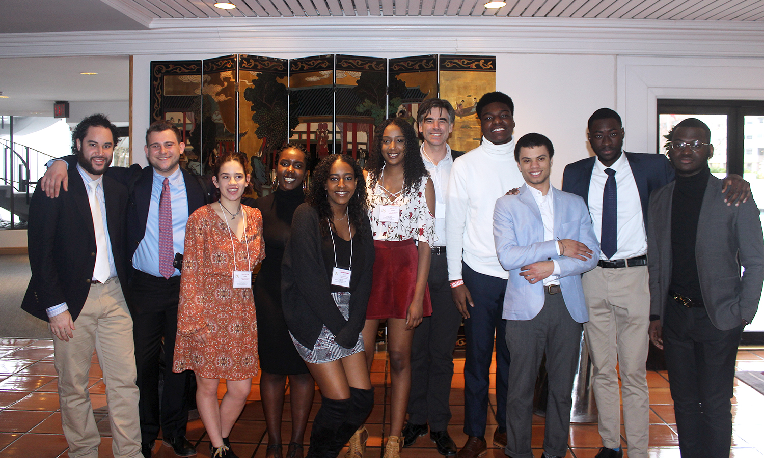 The HWS Model African Union gathers for a photo with Associate Professor of Sociology Christopher Annear (center) after participating in the 2018 International Model African Union Conference at Howard University.