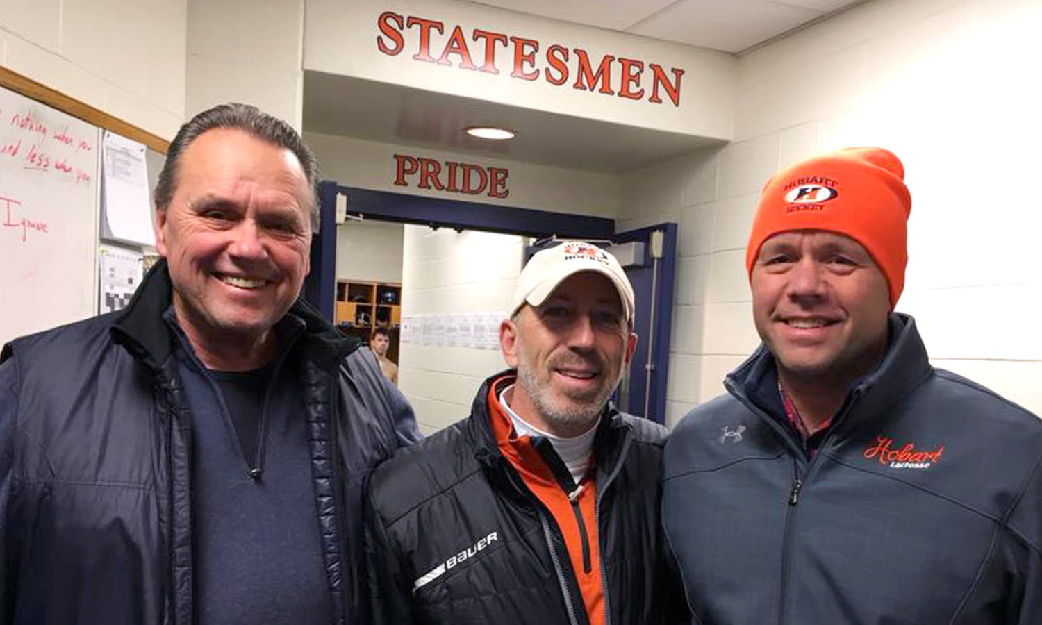 Hank Holden '63, P'89, P'84, GP'20, Scott Mason '81, P'13 and Scott Holden '84, P'20 gather in the Hobart Hockey locker room tonight after Hobart triumphs over Babson, 3-2 at The Cooler.
