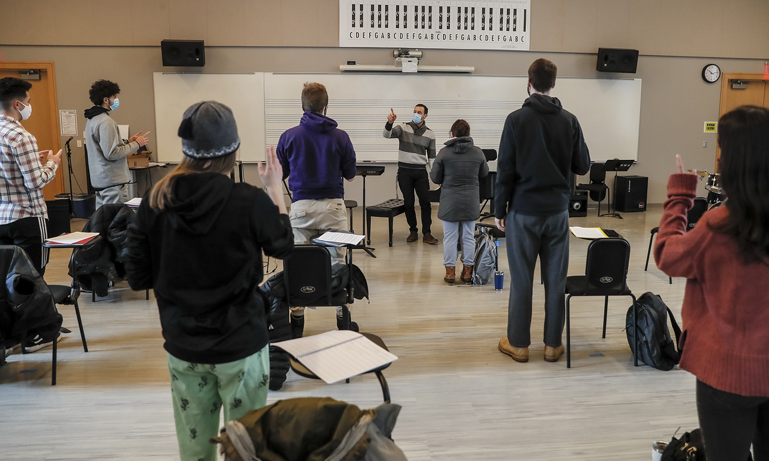 Associate Professor of Music Mark Olivieri leads a class activity on musical intervals.