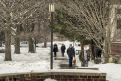 Students walk by Smith Hall.