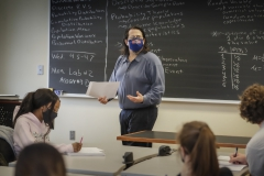 """Assistant Professor of Economics Kellin Stanfield leads a discussion on random variables and the probability distribution of rolling two die during """"Statistics."""""""