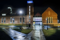 Students walk by the Gearan Center for the Performing Arts on Tuesday evening.