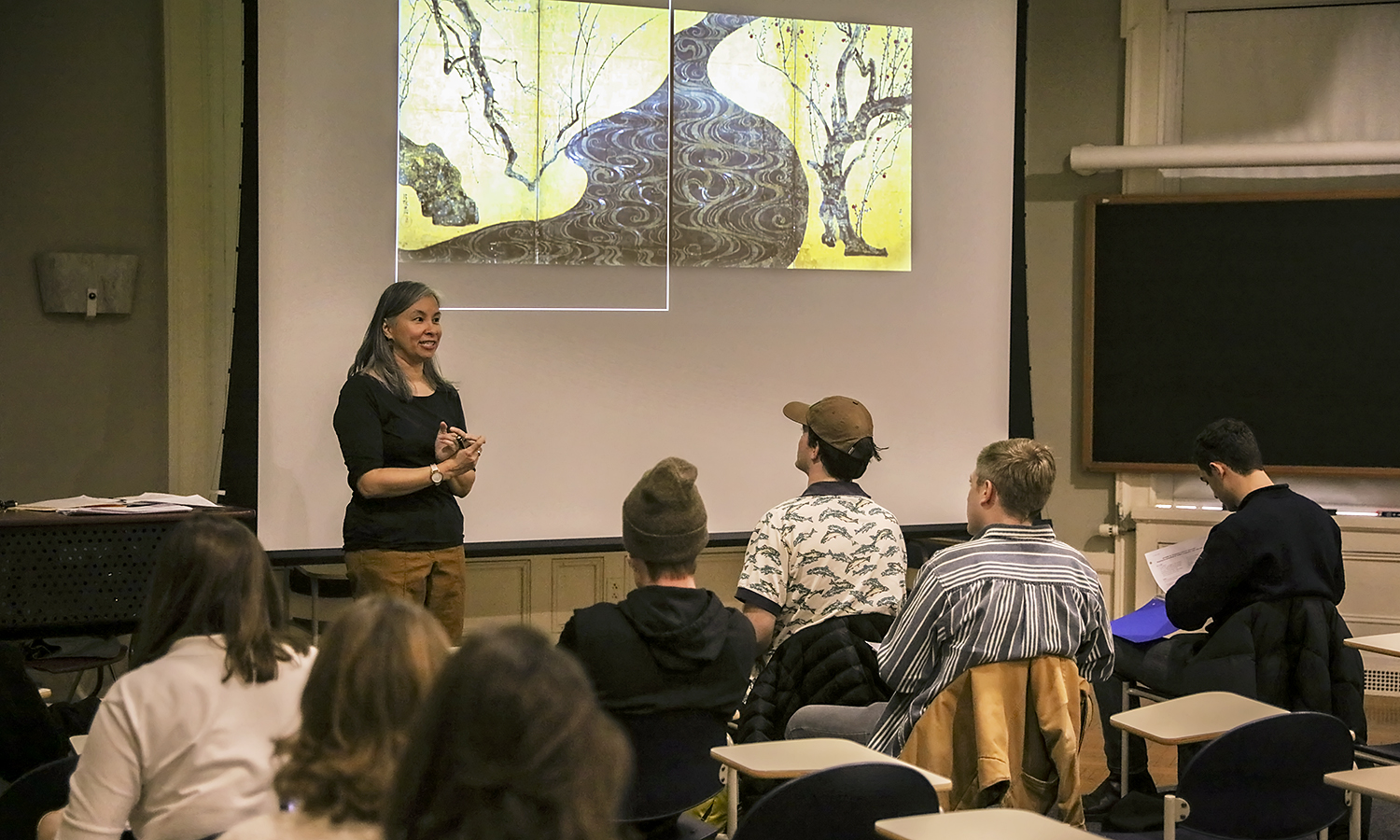 "During ""Introduction to Asian Art,"" Professor of Art and Architecture Lara Blanchard explains how to analyze two-dimensional art using <Red and White Plum Trees</i> by the Japanese artist Ogata Korin."