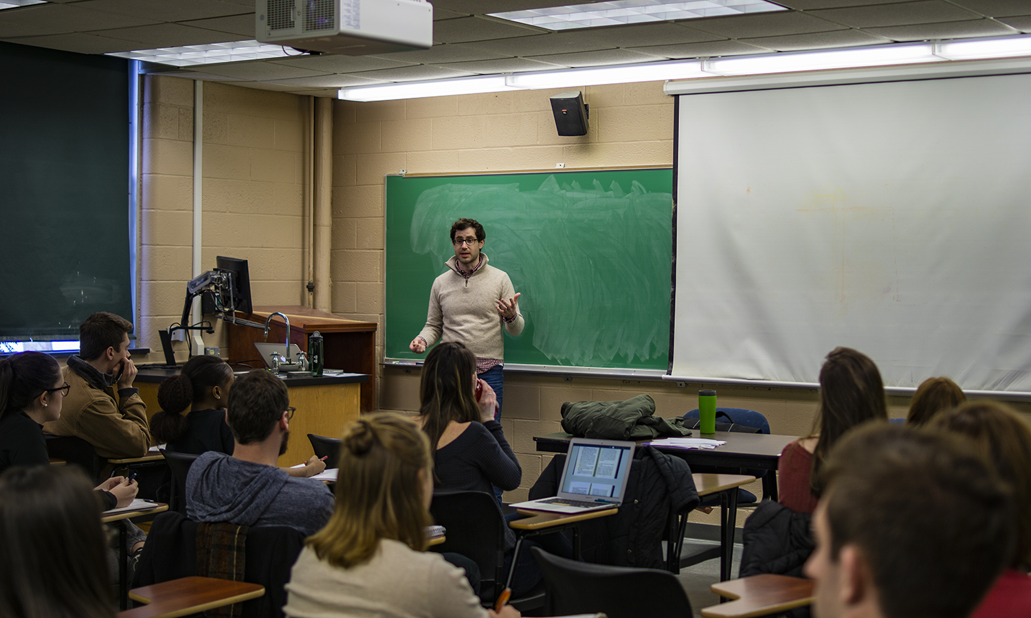 "In Demarest, Robinson Murphy Photos: Visiting Professor of Environmental Studies Robinson Murphy discusses the book ""Walkabout"" with students in ""Human Values and the Environment."""
