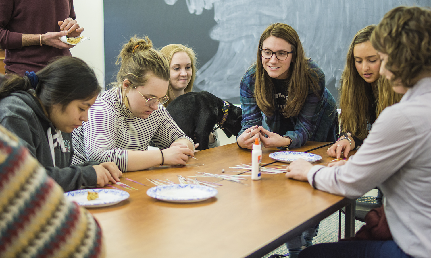 Elizabeth Anderson '19 leads students in making paper beads as part of the Kenyan Crafts edition of the Global Cafe.