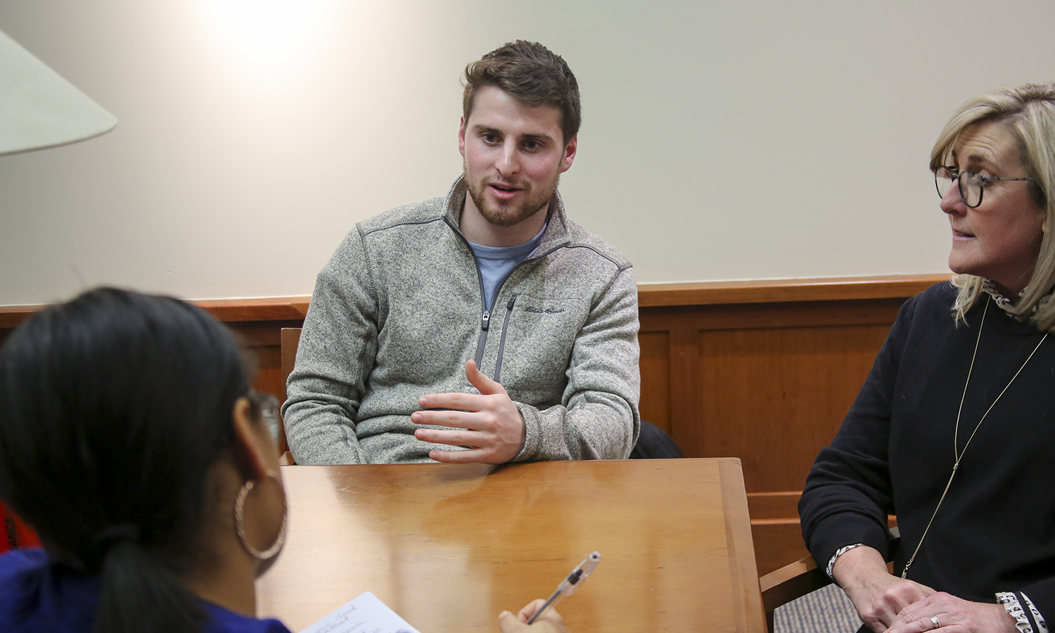 "Student Trustee Gavin Gross '19 and Program Coordinator for the Center for Community Engagement & Service Learning Shayne Feinberg (right) speak to Carolyn Martinez-Diaz '19 during the ""Senior Spring Into Success"" Event in the Salisbury Center for Career, Professional and Experiential Education."