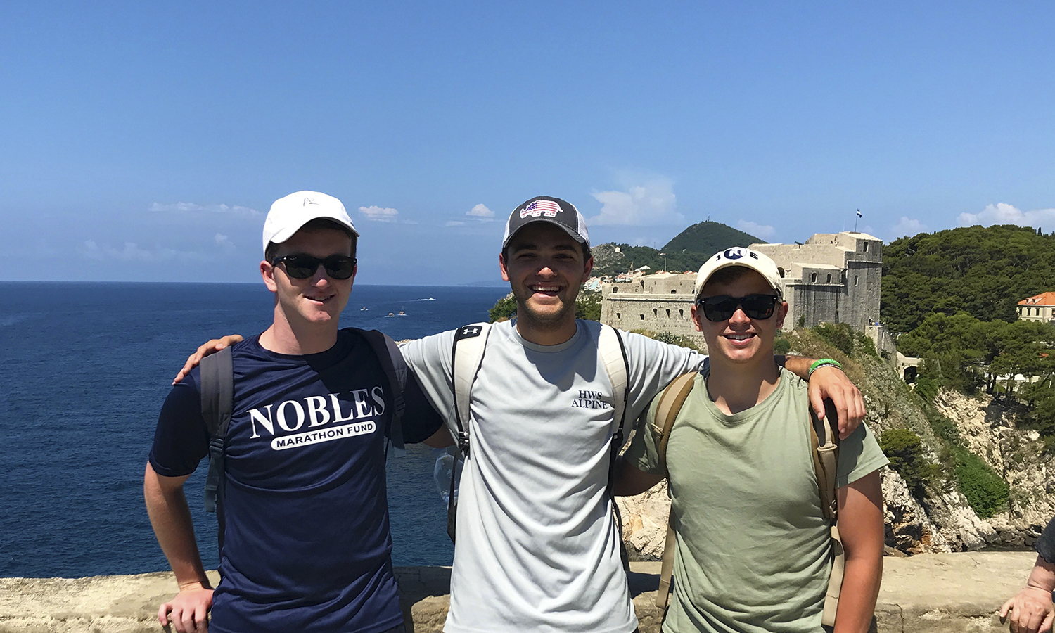 Colby Fenn '20 (center) meets hometown friends while studying abroad in Edinburgh, Scotland.