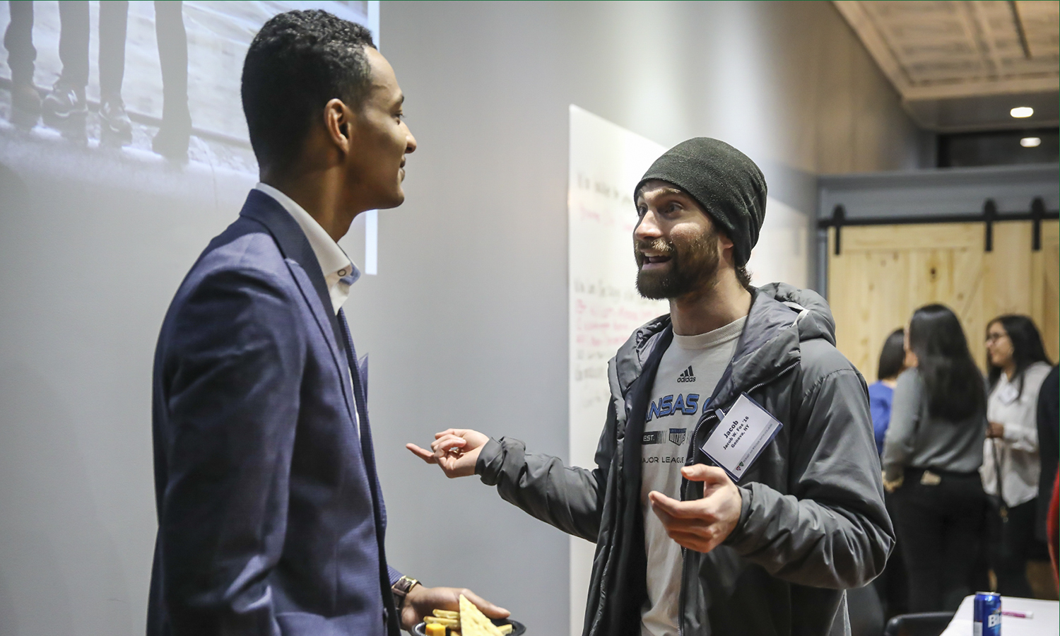 Kwame Morris '19 chats with CEO at Closed Loop Systems LLC and Climate Smart Coordinator for the Town of Geneva Jacob Fox '16 during the Young Alum Happy Hour at the Bozzuto Center for Entrepreneurship. Morris recently accepted a job with the Bozzuto Group in Miami, FL.