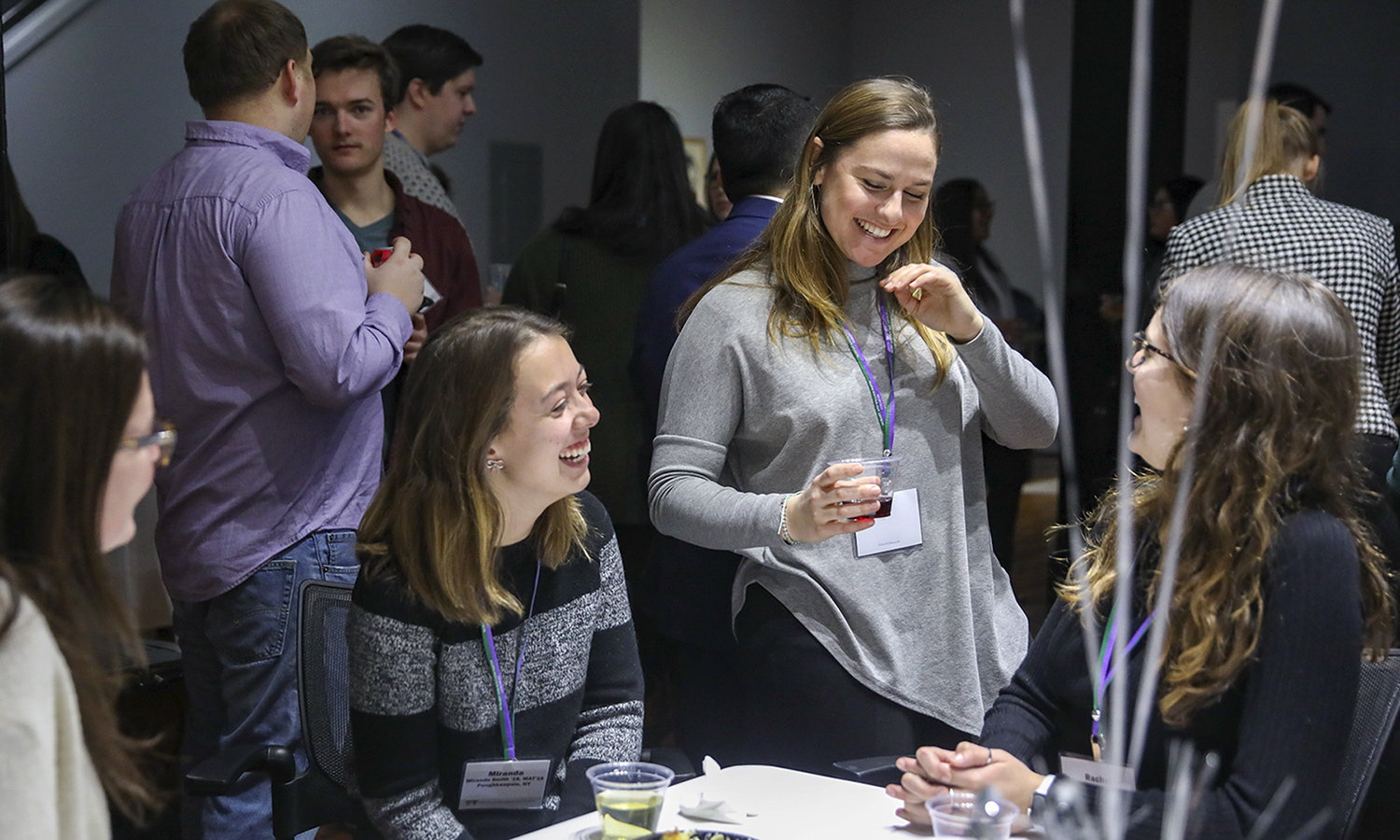 Miranda Smith '19, Assistant Director of Admissions Christine Moloney '17 and Rachel Evans '19 share a laugh during the Young Alum Happy Hour in the Bozzuto Center for Entrepreneruship.