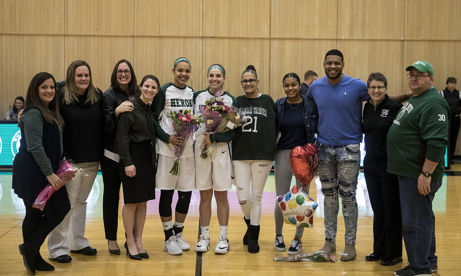 William Smith Seniors Mia Morrison '19 and Olivia Hughes '19  are honored by friends and family for their contributions to the WIlliam Smith Basketball Team during saturday's senior night celebrations. The Herons would later go one to defeat Bard with a score of 74-38.