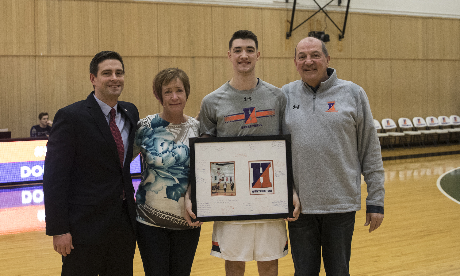 Colin Dougherty '19 is honored for his contributions to the basketball program by his coaches and family at saturday's senior night event. The Statesman went on to defeat Bard 83-80.