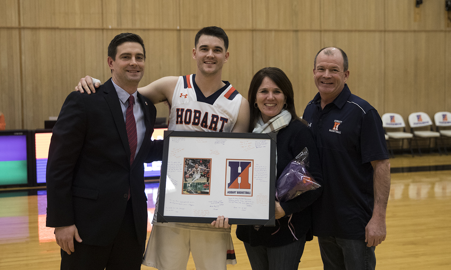 Sean McKinless '19 is honored for his contributions to the basketball program by his coaches and family at saturday's senior night event. The Statesman went on to defeat Bard 83-80.