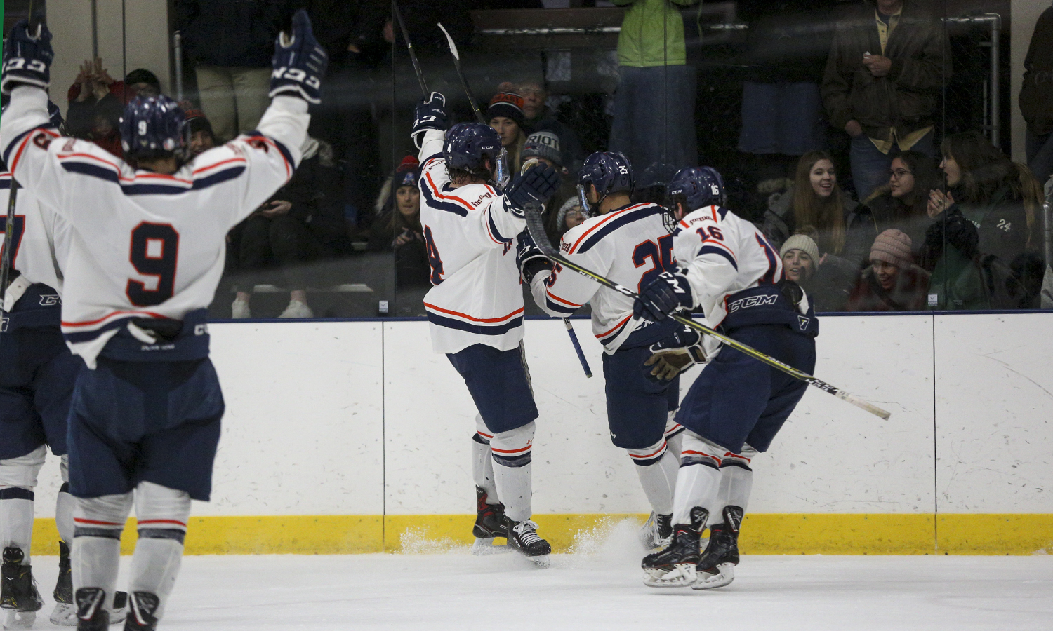 Members of the Hobart Hockey team celebrate after a goal in front of the fans at the Cooler.