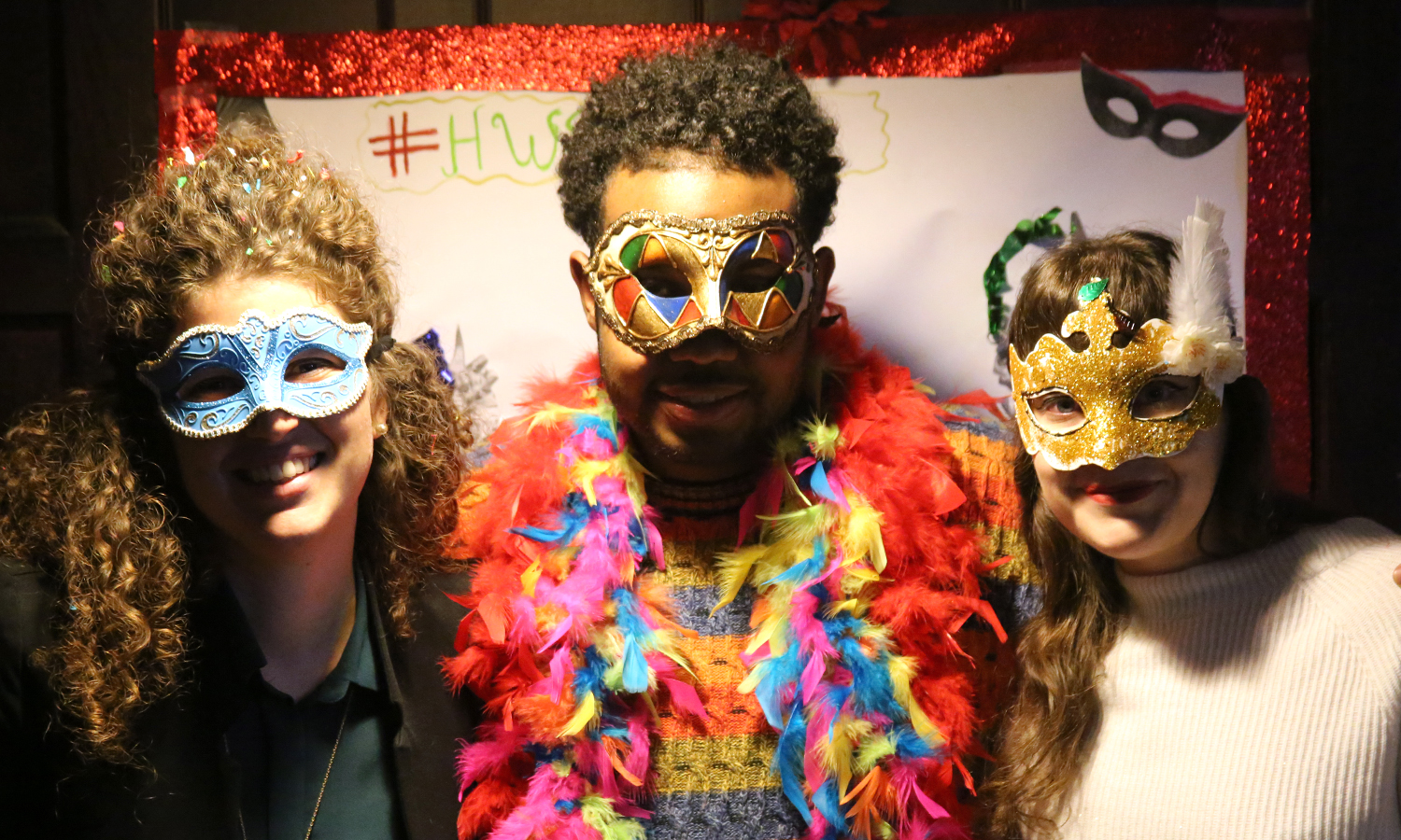Italian Fulbright Teaching Fellow Alessandra Bottacin, Josh Martin '18 and French Fulbright Teaching Fellow Meghann Fedon pose for a photo during the Carnevale celebration in the Bartlett Theatre.