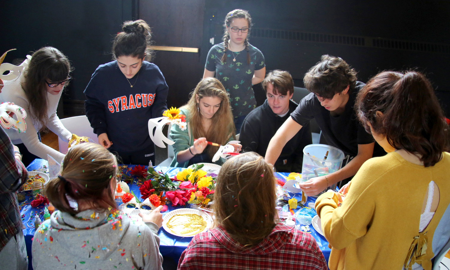 """In the Bartlett Theatre, students craft masks for the """"Carnevale"""" celebration."""