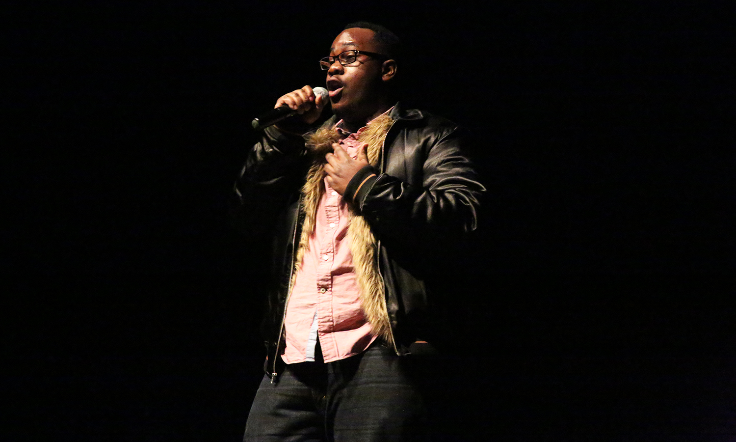 """Josiah Bramble 'X performs during the """"Last Comic Standing"""" event with comedian Maggie May in the Bartlett Theatre."""