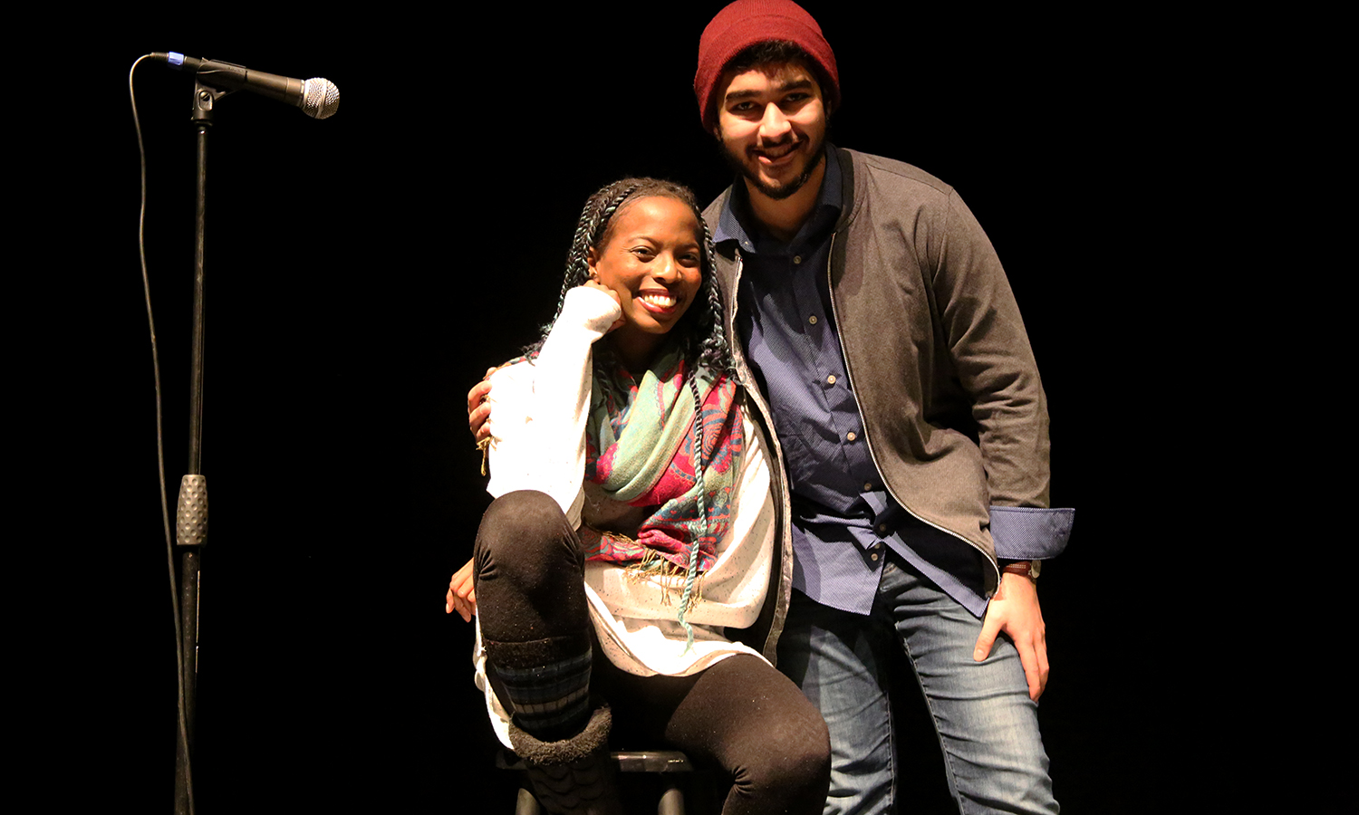 Comedian Maggie May and Arsalan Haider '18 pose for a photo on stage in the Bartlett Theatre.